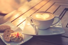 Latte art, coffee on wooden table for morning mood. Relaxing still life image royalty free stock image