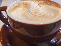 Latte Art. A cozy mug of coffee with a design in the foam on top Royalty Free Stock Photography