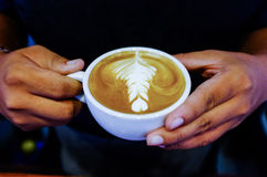 Latte art. In a cup Stock Photos