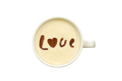 Latte art - isolated cup of coffee with 'love' drawing Royalty Free Stock Photo