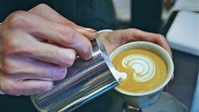 Latte art pouring royalty free stock photo