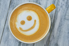 Latte art smiley face. Top view of coffee. Surprising facts about caffeine stock photos