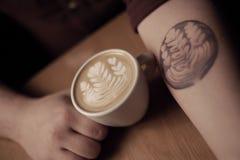 Latte art tattoo Stock Photos