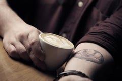Latte art tattoo Stock Photography