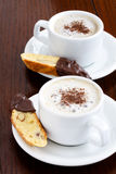 Latte and biscotti Royalty Free Stock Photography
