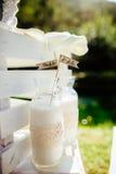 Latte in bottiglia di vetro con la decorazione Fotografia Stock