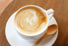Latte or cappuccino coffee with wooden spoon Stock Photo