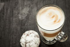 Latte cappuccino with cookies on a black background. White coffee on the table close up Royalty Free Stock Photos
