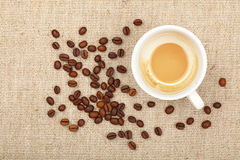 Latte cappuccino cup and coffee beans on canvas Royalty Free Stock Photos