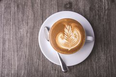 Latte or Cappuccino with frothy foam, coffee cup top view on table in cafe stock photo