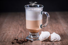 Latte coffe glass with beans and meringue Stock Photos