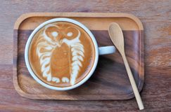 Latte Coffee art Owl and wood spoon Royalty Free Stock Image