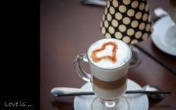 Latte Coffee art on the wooden desk Stock Photos