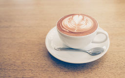 Latte Coffee art on the wooden table ,background Royalty Free Stock Images