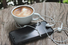 Latte coffee in cup and smart phones Stock Photography