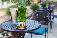 Latte coffee cup on table in cafe Stock Photo