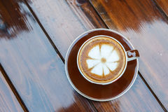 Latte coffee cup on table in cafe Royalty Free Stock Image