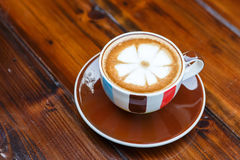 Latte coffee cup on table in cafe Royalty Free Stock Photography
