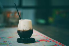 Latte coffee. A glass of Black coffee with milk in vintage cafe royalty free stock photos