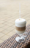 Latte coffee in a glass mug with straw Royalty Free Stock Image