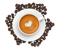Latte coffee with heart symbol over roasted coffee beans Stock Photo