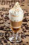 Latte coffee and spilled coffee beans Stock Photography