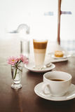 Latte and coffee on table Royalty Free Stock Photos