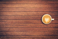 Latte coffee on table wood background with space royalty free stock image
