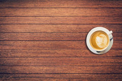 Latte coffee on table wood background with space royalty free stock photography