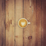 Latte coffee on wood background and texture Royalty Free Stock Photography