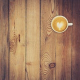 Latte coffee on wood background and texture Stock Photo