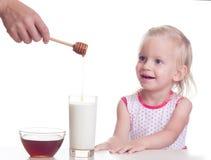Latte con miele Fotografie Stock
