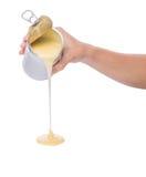 Latte condensato di versamento II Fotografia Stock Libera da Diritti