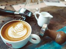 Latte on Cup Beside Milk Cup stock image
