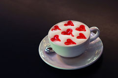 Latte cup wtih hearts Stock Images