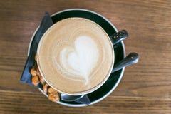 Latte de café avec l'art de latte Photographie stock