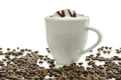 Latte del café con los granos de café Fotografía de archivo libre de regalías