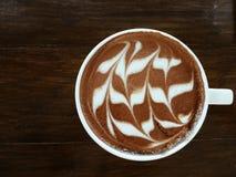 Latte del café en la tabla de madera Imágenes de archivo libres de regalías