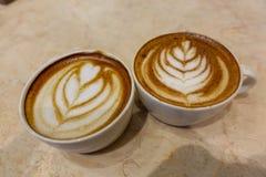 Latte del caffè e della tazza da caffè Fotografia Stock