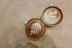 Latte del caffè e della tazza da caffè Immagini Stock