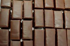 Latte del ` s dell'uccello nella glassa del cioccolato Fotografie Stock Libere da Diritti