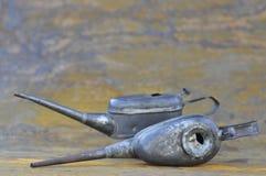 Latte dell'olio dei meccanici Fotografia Stock Libera da Diritti
