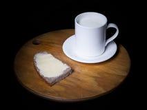 Latte e panino con burro Fotografia Stock