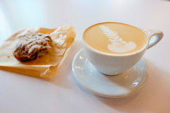 Latte with Foam Art at Coffee Shop Royalty Free Stock Photos