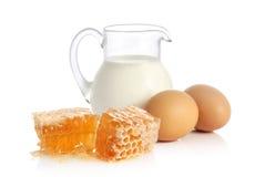 Latte fresco, due uova e miele Fotografia Stock Libera da Diritti