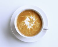 Latte with froth art. Cup of latte with froth art - overhead royalty free stock photography