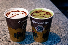Latte from Gundam Cafe. Tokyo, Japan - March 02, 2015: A cappuccino and a green tea latte from the Gundam cafe in Akihabara, Tokyo.  The character on top is Stock Photos