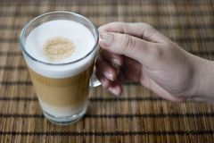 Latte macchiato. A glass of hot colorfull cofee with milk stock images