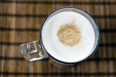 Latte macchiato. A glass of hot colorfull cofee with milk stock photography