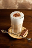 Latte macchiato. Photo of  hot beverage called latte macchiato which is composed of milk and coffee Stock Photos